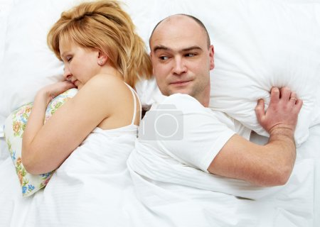 Photo for Photo of dissatisfied husband looking his wife - Royalty Free Image