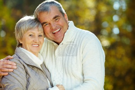 Photo for Photo of amorous aged man and woman looking at camera - Royalty Free Image