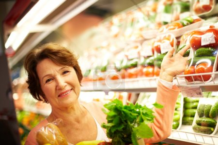 Photo for Image of senior woman in groceries department - Royalty Free Image
