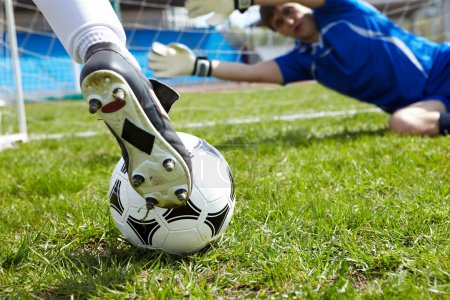 Photo for Horizontal image of soccer ball with foot of player kicking it - Royalty Free Image