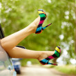 Photo of nice legs of elegant woman stuck from car...