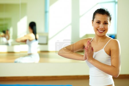 Photo for Portrait of happy girl during yoga practice in gym - Royalty Free Image