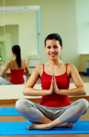 Photo for Portrait of happy girl meditating in gym - Royalty Free Image