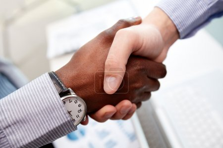 Photo for Close-up of businessmen shaking hands, Caucasian and African-American - Royalty Free Image