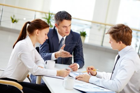 Photo for Mature team leader motivate young employee by gesture to share his business ideas - Royalty Free Image