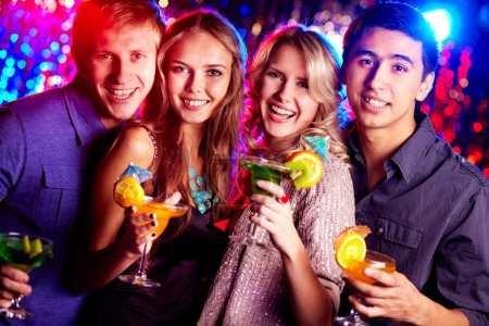 Photo for Image of two happy couples holding glasses of cocktails - Royalty Free Image
