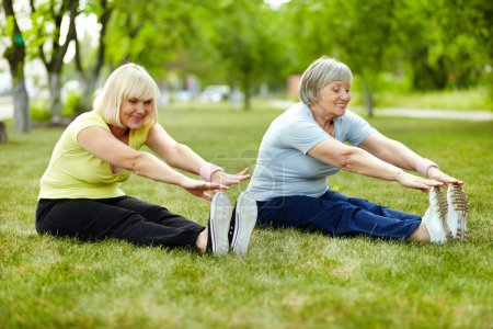 Photo for Senior ladies enhancing body flexibility by stretching - Royalty Free Image