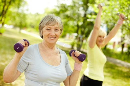 Photo for Pleasant mature females working out in the open air - Royalty Free Image