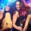Cheerful girls living it up on the dance floor...