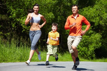 Photo for Lovely family jogging in the open air - Royalty Free Image
