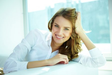 Photo for Image of a young woman with a lovely look and charming smile - Royalty Free Image