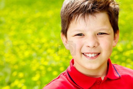 Photo for Close-up portrait of happy boy outside - Royalty Free Image