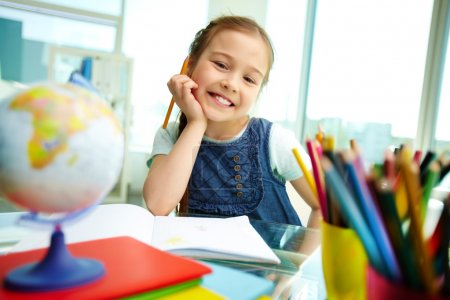 Photo for Portrait of lovely girl looking at camera while drawing - Royalty Free Image