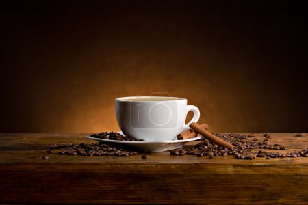 Photo for Coffee cup and coffee beans on dark background - Royalty Free Image
