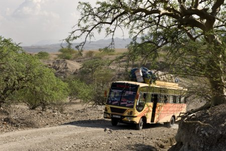 Bus traveling on dirt road, Tanzania, Africa