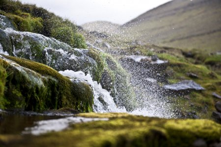 Splashing water of waterfall on Faroe Islands