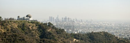 Skyline of Los Angeles with the Griffith observatory in the foreground, California, USA