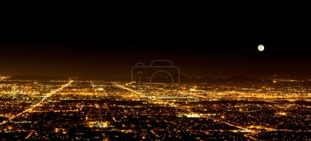 Photo for The Super Full Moon on May 5, 2012 over the city light of Phoenix Arizona. Photograph was taken from the top of South Mountain. - Royalty Free Image