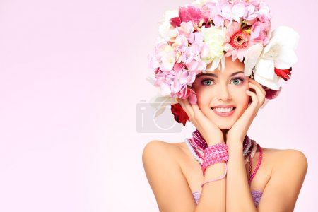 Photo for Portrait of a beautiful spring girl wearing flowers hat. Studio shot. - Royalty Free Image