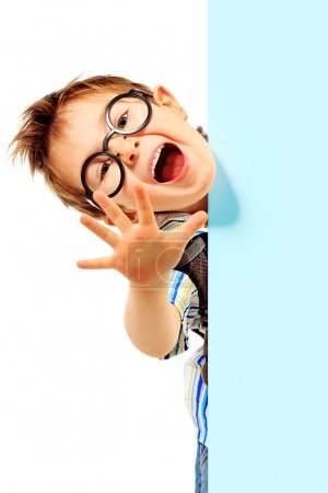 Photo for Portrait of a little boy in spectacles with white board. Isolated over white background. - Royalty Free Image