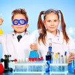 Two children making science experiments. Education...