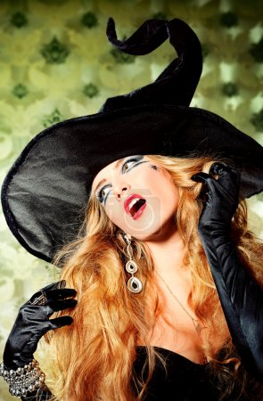 Charming halloween witch over vintage background....