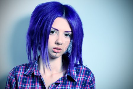 Portrait of a punk girl with purple hair....