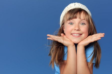 Photo for Portrait of a cheerful girl over blue sky. - Royalty Free Image