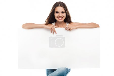 Photo for Beautiful woman holding a blank billboard isolated on white background - Royalty Free Image
