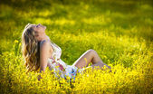 Young attractive girl outdoor in the field. Blonde girl