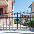 Steel security gates leading to a residential area...