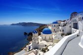 Santorini island with churches and sea view in Greece