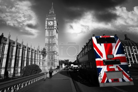 Big Ben with colorful flag of England in London