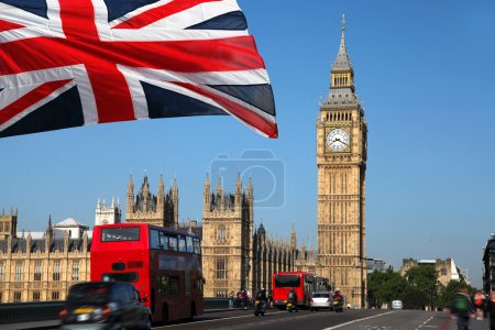 Famous Big Ben with bridge and buses on it during ...