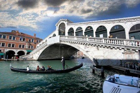 Ponte Rialto bridge with gondola