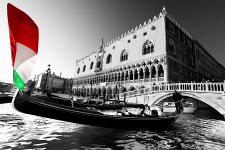 Gondola with colorful flag of Italy, Venice