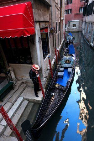 Gondolier waiting for customer in Italy