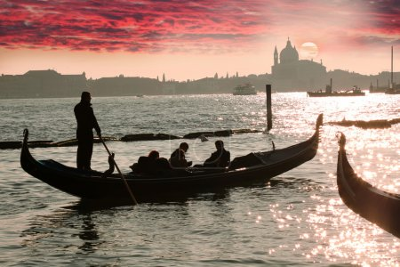 Venice, Gondola against colorful sunrise, Italy