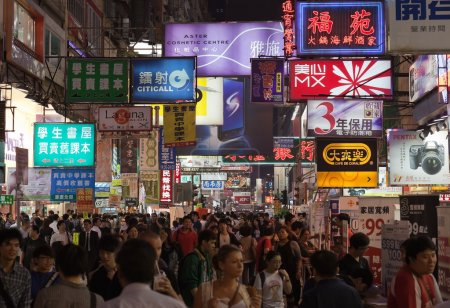 Busy street market at Night. Hong Kong.