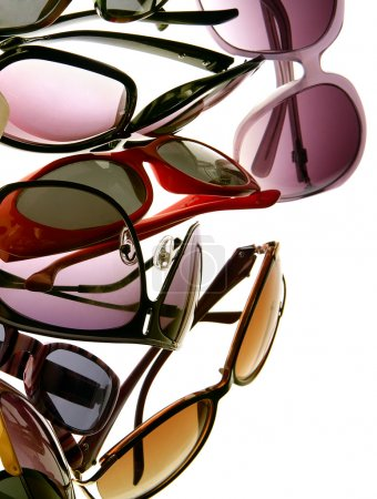 Photo for Assorted styles of tinted sunglasses on white background - Royalty Free Image