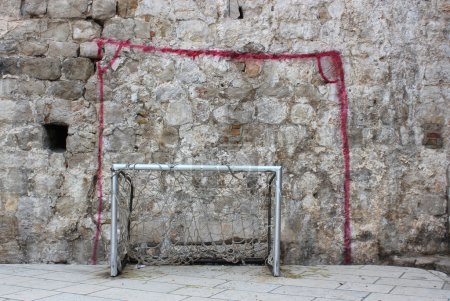 Wall-painted and real goalposts