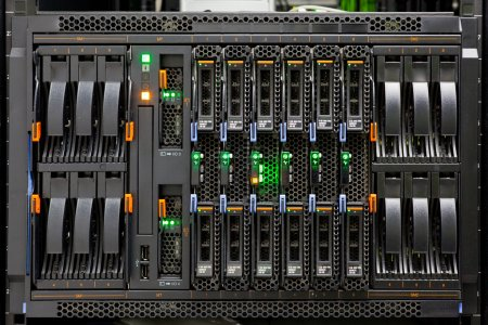 Photo for Network Server Rack Panel with hard disks in a data center. - Royalty Free Image