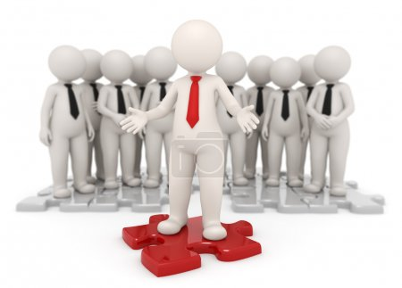 Photo for Successful business leader standing on a red puzzle piece in front of his team - Isolated - Royalty Free Image