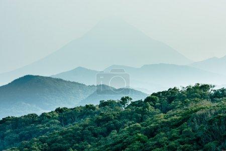 Photo pour Layered hills with Mount Kaimon (Kaimondake) in the background - image libre de droit