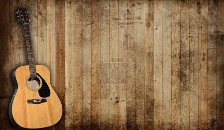 Photo for Acoustic guitar against an old barn background. - Royalty Free Image