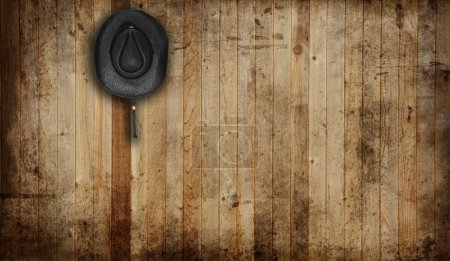 Photo for Cowboy hat, against an old barn background. - Royalty Free Image