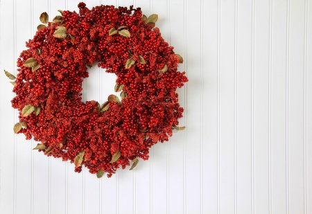 Photo for Country red berry Christmas wreath. - Royalty Free Image