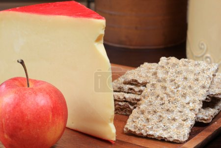 Photo for Gouda cheese platter with apple and crackers. - Royalty Free Image