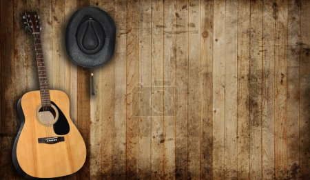 Photo for Cowboy hat and guitar against an old barn background. - Royalty Free Image