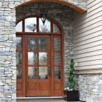 Elegant front door of a brand new executive home....
